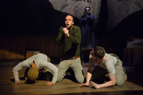 (L-R): CJ (Christopher Livingston), Big Joe (Ian Merrigan), and Coughlin (Jon Beavers) face the horrors of war in The Unfortunates, playing at A.C.T.'s Strand Theater through Sunday, April 10. (Background: Ramiz Monsef). Photo by Kevin Berne.