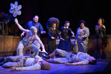 (L-R standing): Koko (Eddie Lopez), Preacher (Arthur Wise), Madame (Danielle Herbert), Roxy (Lauren Hart), Handsome Carl (Amy Lizardo), and Rae (Taylor Iman Jones) mourn the deaths of CJ (left, Christopher Livingston) and Coughlin (Jon Beavers) in The Unfortunates, playing at A.C.T.'s Strand Theater through Sunday, April 10. Photo by Kevin Berne.