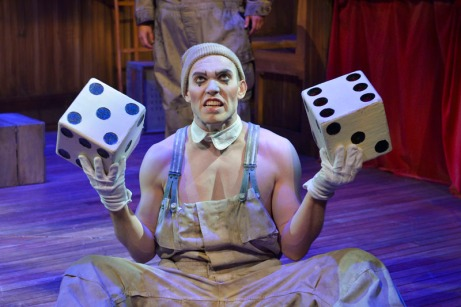 Koko (Eddie Lopez) offers up a game of chance in The Unfortunates, playing at A.C.T.'s Strand Theater through Sunday, April 10. Photo by Kevin Berne.
