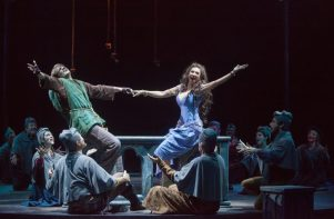 (L to R) John McGinty as Quasimodo, Lesli Margherita as Esmeralda and the company of The Hunchback of Notre Dame, produced by Music Circus at the Wells Fargo Pavilion August 23-28. Photo by Charr Crail.